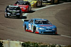 Johnny Sauter's Chevy Monte Carlo gets a few car lengths lead on the field