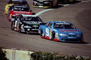 Johnny Sauter's Chevy Monte Carlo holds on to the lead