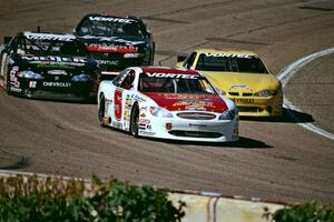 Scott Hansen's Ford Taurus leads a group