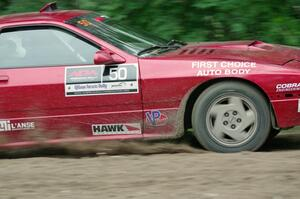 Al Dantes, Jr. / Brandon Snyder Mazda RX-7 Turbo at a sharp left on SS6, Steamboat II.