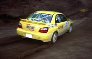 Steve Gingras / Phil Strohm drift their Subaru WRX through a fast sweeper on SS1.