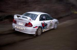 Brian Scott / David Watts drift through a sweeper on SS1 in their Mitsubishi Lancer Evo IV.
