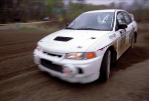 Brian Scott / David Watts drift their Mitsubishi Lancer Evo IV through a 90-left on SS2.