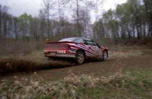 Mike Cienkosz / Yurek Cienkosz set up their Mitsubishi Eclipse GSX for a 90-left on SS2.