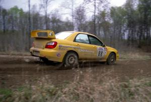 Graham Price / Scott Putnam set up their Subaru WRX STi for a 90-left on SS2.