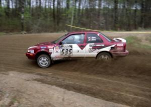 Jake Himes / Silas Himes drift through a 90-left on SS2 in their Nissan Sentra SE-R.