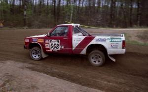 Jim Cox / Kaari Cox drift out of a 90-left on SS2 in their Chevy S-10.