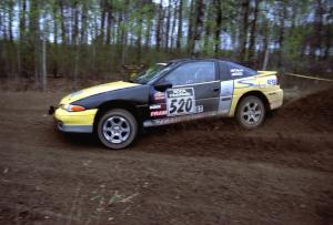 Eric Olson	 / Adam Skoog drift their Eagle Talon through a 90-left on SS2.