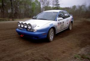 Micah Wiitala / Jason Takkunen drift through a 90-left on SS2 in their Saturn SL2.