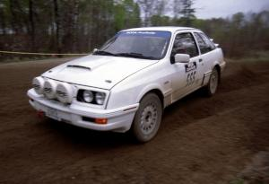 Colin McCleery / Nancy McCleery drift through a 90-left on SS2 in their Merkur XR4Ti.