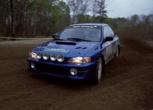 Kazimierz Pudelek / Mark Pudoluch drift through a 90-left on SS2 in their Subaru Impreza.