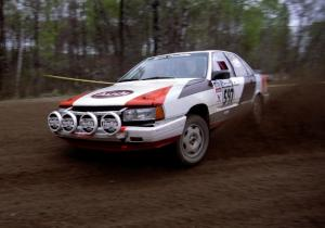 Rob Dupree / Travis Kriza at speed through a 90-left on SS2 in their Audi 100 Quattro.