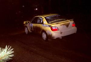 Steve Gingras / Phil Strohm at speed in their Subaru WRX at night.