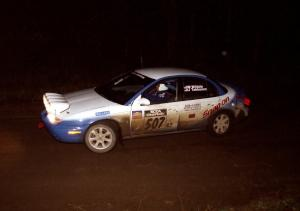 Micah Wiitala / Jason Takkunen set up for a sweeping left at night in their Saturn SL2.