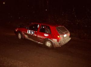The Karl Biewald / Ted Weidman VW GTI at speed at night near the end of the event.