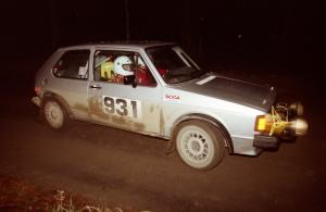 Chris Wilke / Mike Wren at speed down a straight at night in their VW Rabbit.