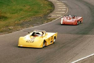 Alan Lewis's Tiga SC80 leads Syd Demovsky's Lola T-590 in the Sports 2000 battle.