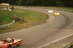 Syd Demovsky's Lola T-590 pulls away from Alan Lewis's Tiga SC80 and John Cahill's Ocelot in the Sports 2000 battle.