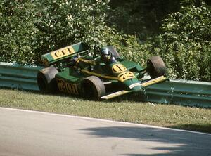Chris Kneifel's Primus LR03/Cosworth collects the inside guardrail at turn 12 on lap 2.