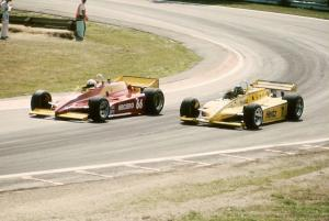 Pete Halsmer's Penske PC10/Cosworth makes an inside pass on Al Unser, Sr.'s Penske PC11/Cosworth