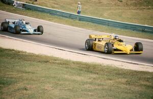 Al Unser, Sr.'s Penske PC11/Cosworth ahead of Danny Ongais's March 83C/Cosworth