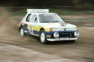 The Jon Woodner / Tony Sircombe Peugeot 205 T16 at speed on SS1 at the speedway.