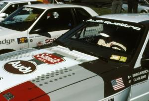 Clark Bond sits in the passenger seat of Bruno Kreibich's Audi Quattro reviewing notes before the start.