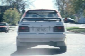 Rod Millen / Harry Ward in their Gr. A Mazda 323GTX in transit to SS2.