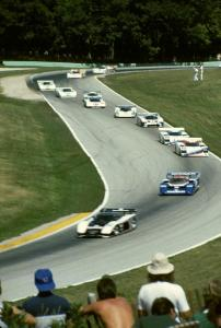 The field comes through turns 6 and 7 on the pace lap.
