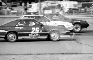 Showroom Stock A Battle: Gerry Mason's Mitsubishi Starion leads Bill Holcomb's Pontiac Sunbird and Chuck Neuman's Dodge Charger