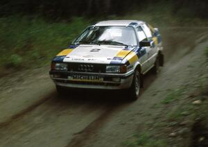 Paul Choiniere / Doug Nerber fly down a straight in the Paul Bunyan forest in their Audi Quattro.