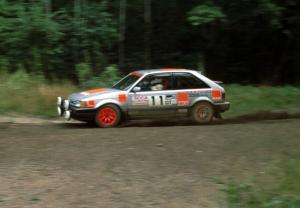 Jeff Zwart / Cal Coatsworth in their Mazda 323GTX at a hairpin.