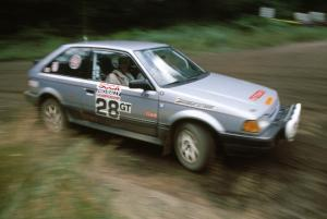 Allan George / Gary Judy fly by in their PGT class Mazda 323GTX running in Group A.