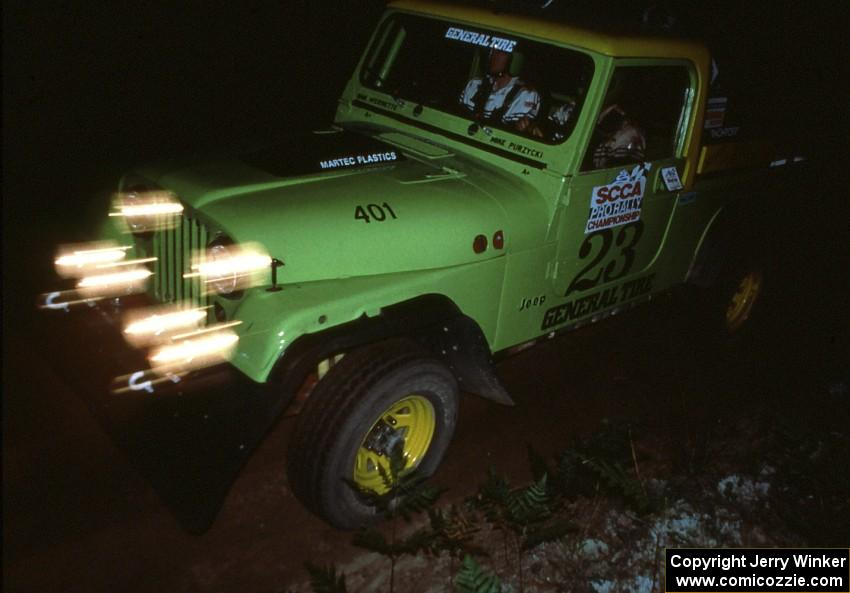 Mike Purzycki / Dan Werenette ran the club rallies in ther Jeep Scrambler seen here running on Friday night.