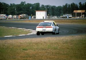 John Schneider / Ron Nelson Nissan 300ZX Turbo chases two other cars into turn 4
