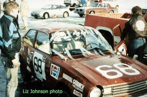 Jerry Winker looks at the damage after rolling the Dodge Colt he and John Martin shared.