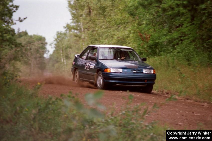 The Tad Ohtake Bob Martin Ford Escort Gt At Speed Down Indian Creek Trail Rd On
