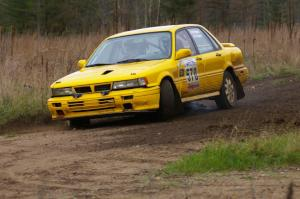Erik Payeur / Adam Payeur Mitsubishi Galant drifts wide at the Parkway Forest Rd. chicane.