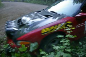 Cary Kendall / Scott Friberg get a little too close at the apex of a hairpin on SS1 in their Eagle Talon.