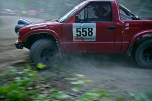 Jim Cox / Ryan LaMothe Chevy S-10 at a hairpin on SS1.