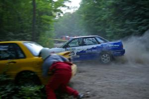 Mike Wray / John Nordlie Subaru Legacy Sport blasts past the stuck Mitsubishi Galant of Erik Payeur / Adam Payeur on SS1.