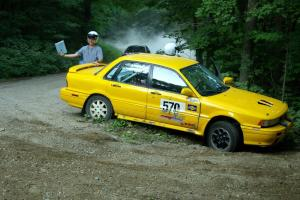 The stuck Erik Payeur / Adam Payeur Mitsubishi Galant flashes the OK sign to the Ryan Johnson / Matt Himes Saturn SL2.