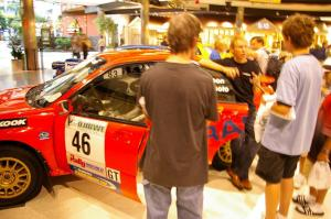 Rally fans check the inside of the Matthew Johnson / Wendy Nakamoto Subaru WRX at Rallyfest at the Mall of America.