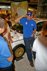 Travis Pastrana talks fans about rallying in front of the Ken Block / Alex Gelsomino Subaru WRX STi.