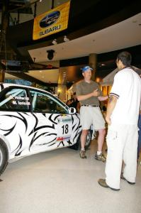 Matt Iorio discusses his Subaru Impreza to new rally fans at the Mall of America. Ole Holter was his navigator for the weekend.