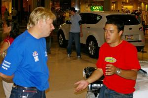 Lance Smith and Pat Richard converse at the Mall of America rally display.