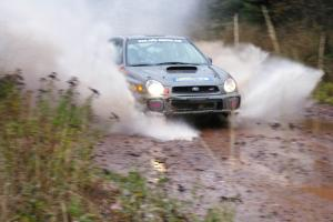 Dave Anton / Alan Ockwell Subaru WRX STi hits the final big puddle at the end of Gratiot Lake 2, SS14, at speed.