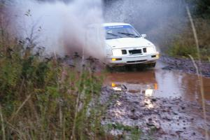 Colin McCleery / Nancy McCleery	Ford Sierra XR8 hits the final big puddle at the end of Gratiot Lake 2, SS14, at speed.