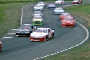 Dick Trickle's Ford Thunderbird and Johnny Benson, Jr.'s Chevy Lumina head the large field through 7/8