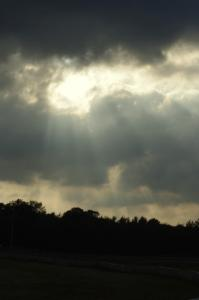 Corpuscular rays through the clouds above the track